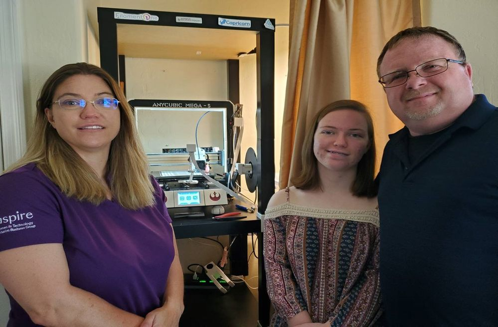 two women and a man with a 3D printer.jpg